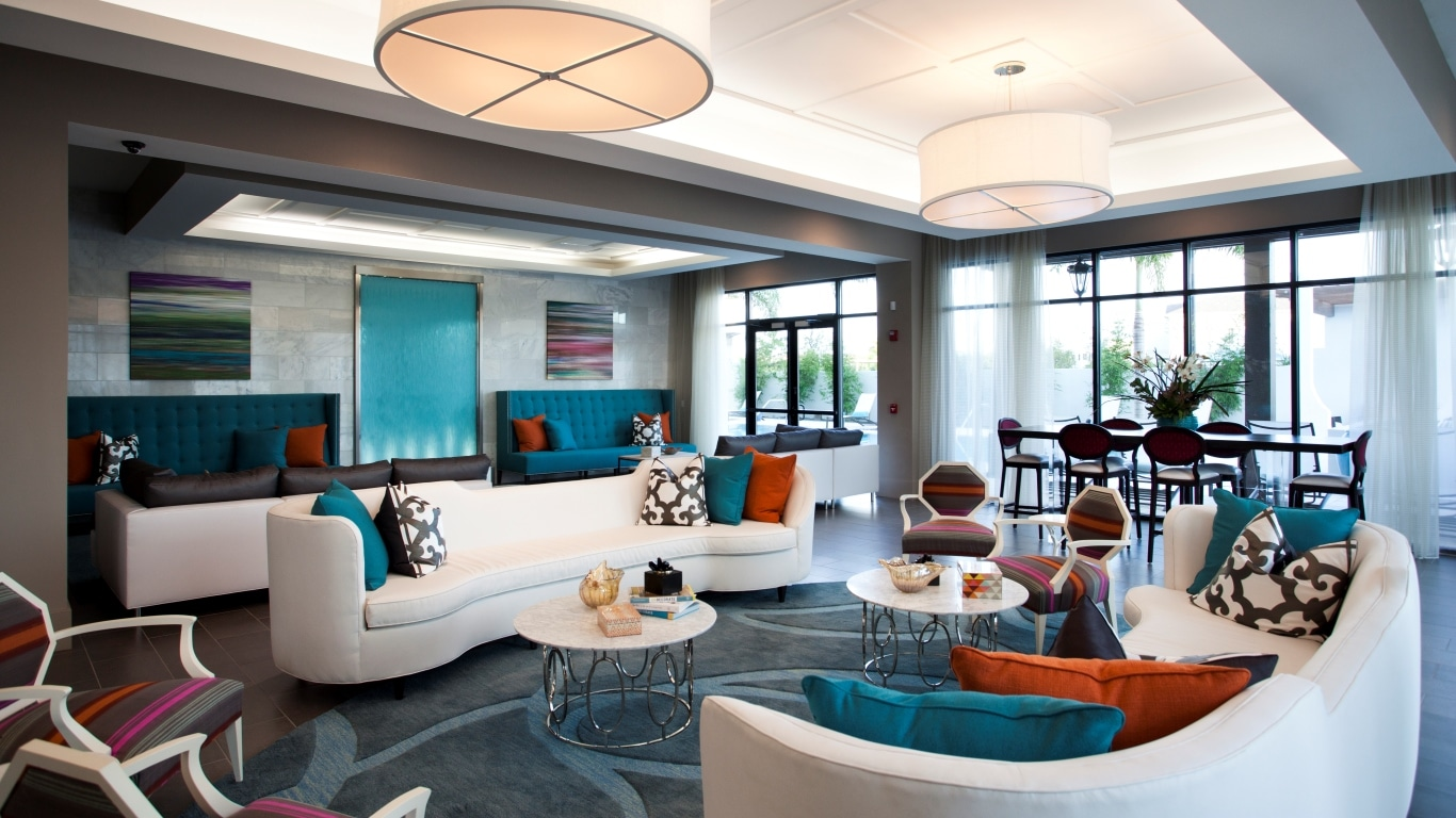 azul resident lounge with colorful social seating, tables, chairs, and modern lighting - jefferson apartment group
