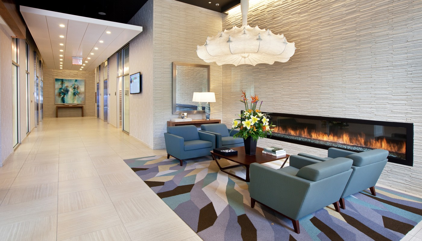 lobby with large fireplace, social seating and modern lighting - jefferson apartment group