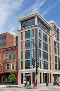14 w exterior showing a six story residential building and commercial development - jefferson apartment group
