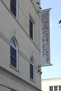 asher banner on exterior - jefferson apartment group