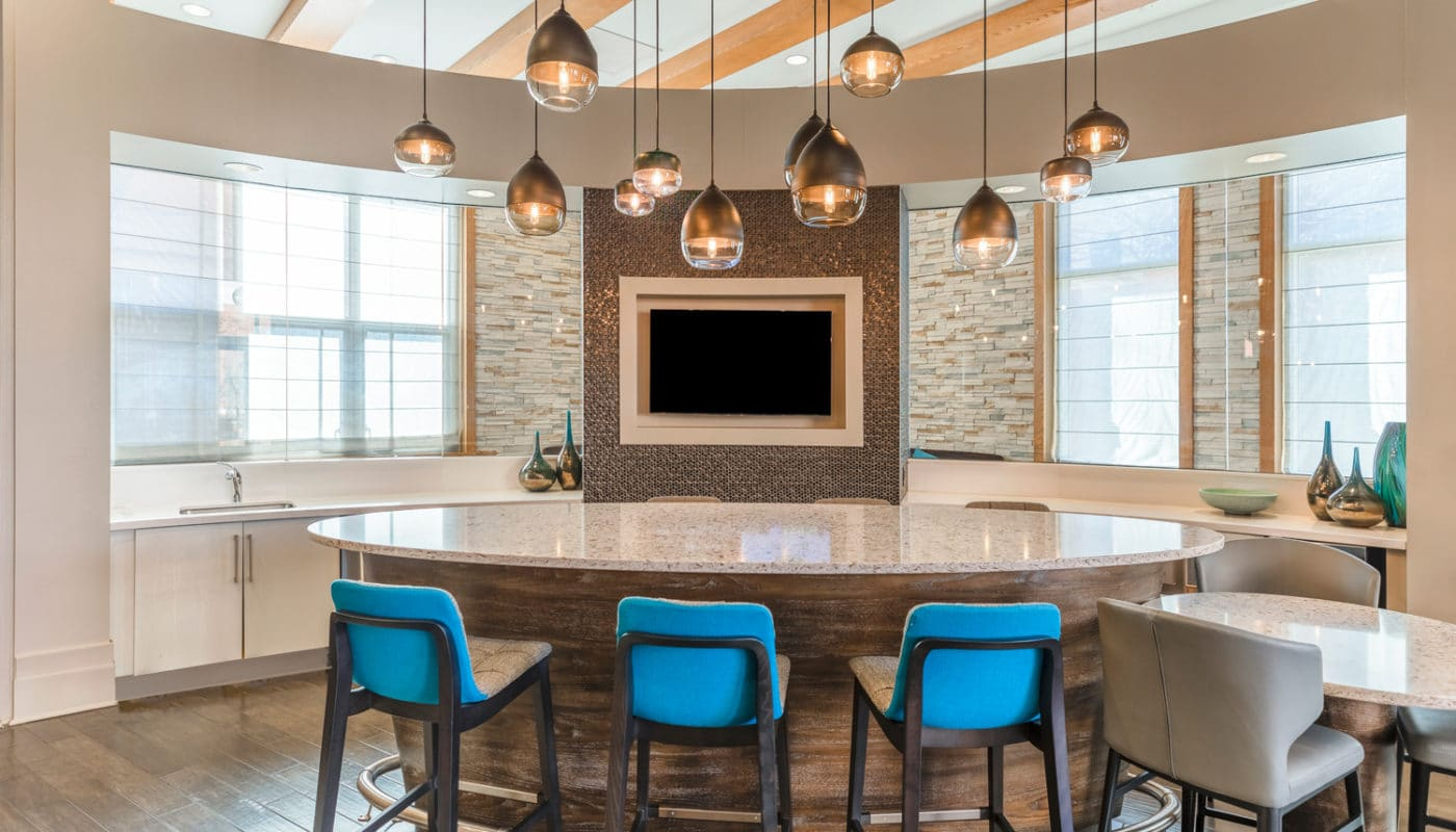lounge bar area with flat screen tv and demonstration kitchen at jefferson marketplace luxury apartments in dc