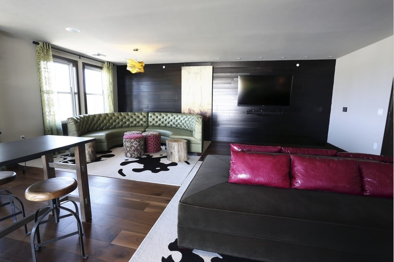 asher club room with social seating, bar seating, flat screen tv and modern lighting - jefferson apartment group