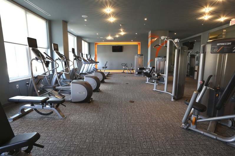 asher fitness center with cardio equipment, strength training machines, flat screen tvs and large windows - jefferson apartment group