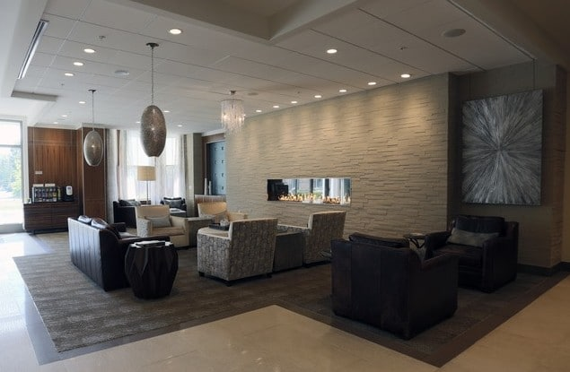 asher lovvy with fire place, social seating, coffee bar, cocktail tables, modern artwork and modern lighting - jefferson apartment group