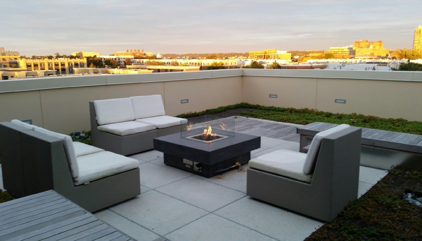 asher rooftop lounge with social seating, bench seating, view of alexandria and fire pit - jefferson apartment group