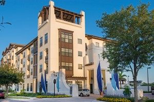 azul exterior showing four story building with flowers, trees, landscaping and parking area - jefferson apartment group
