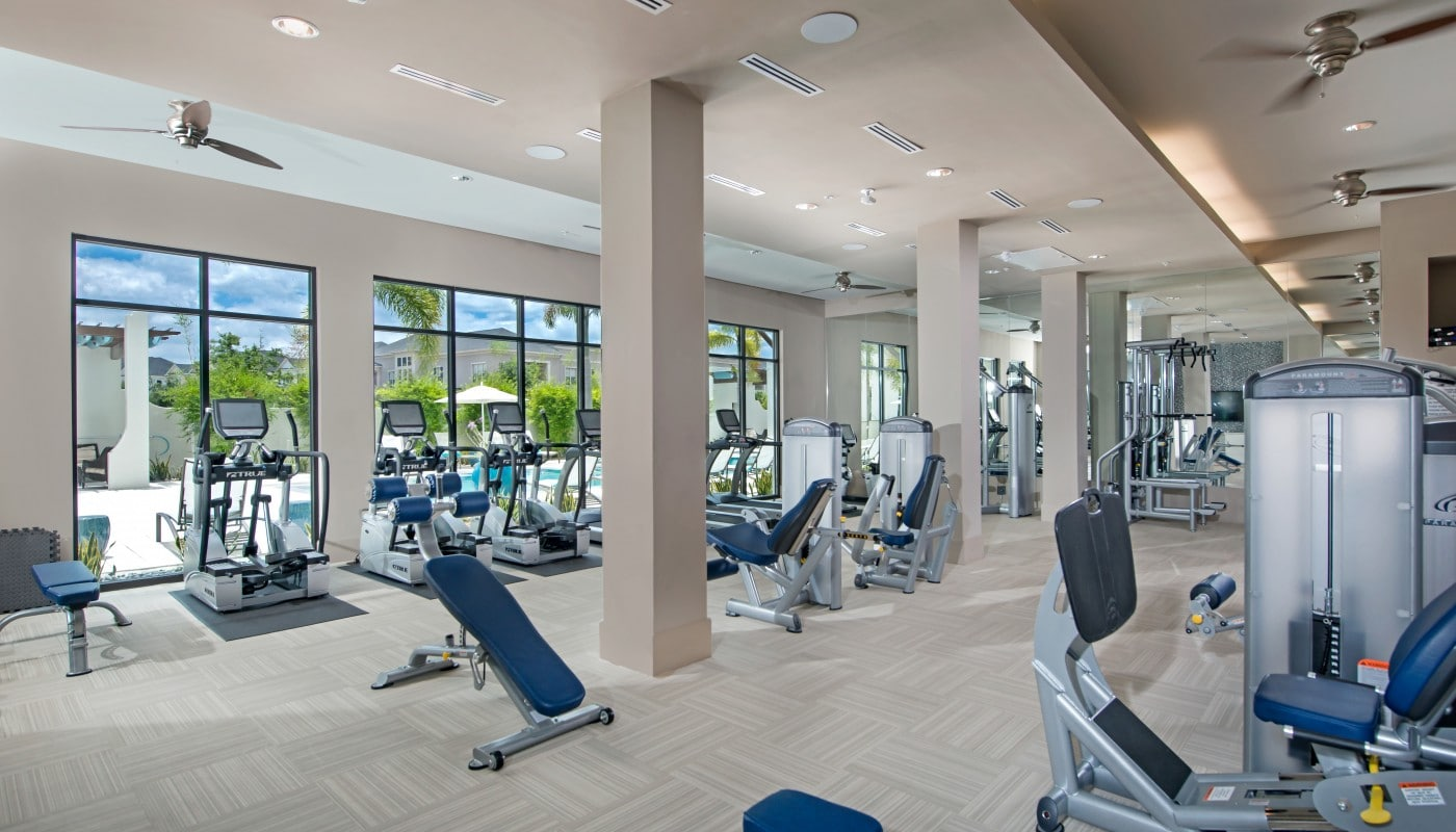 azul fitness center with cardio machines, strength training equipment, ceiling fans, and view of pool - jefferson apartment group