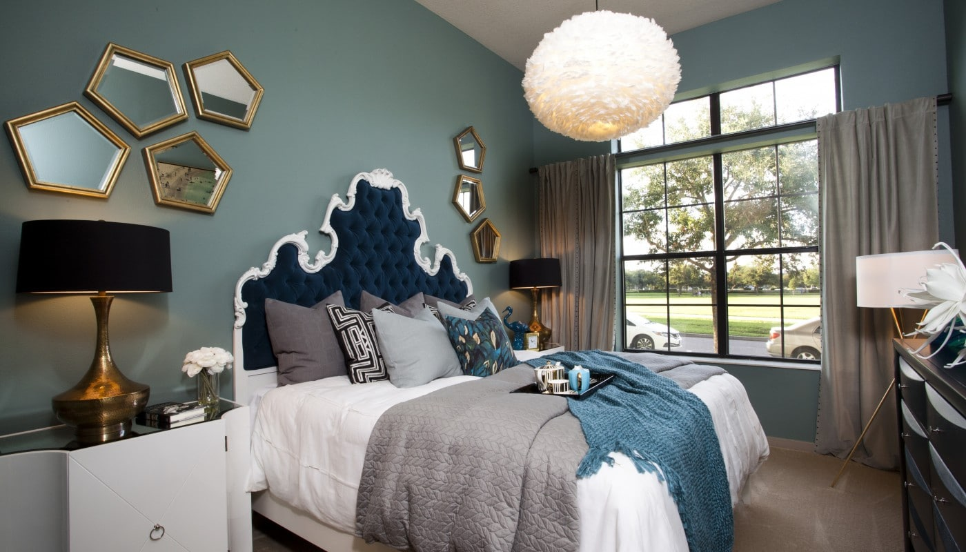 Azul bedroom with bed, night stands, dresser, modern lighting, lamps and large windows - jefferson apartment group