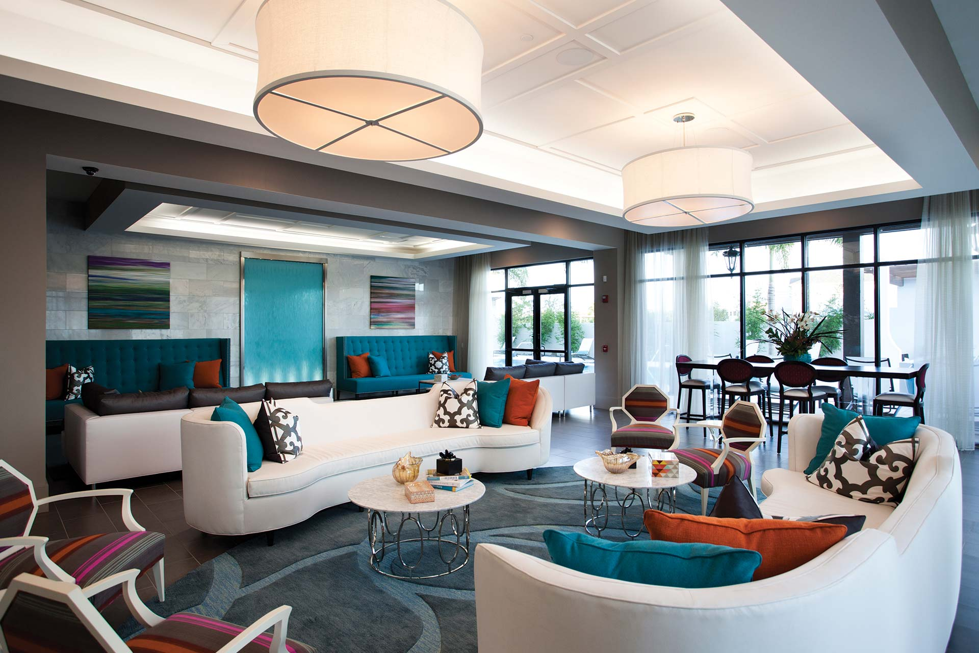 azul resident lounge with social seating, cocktail tables, bench seating and modern lighting - jefferson apartment group