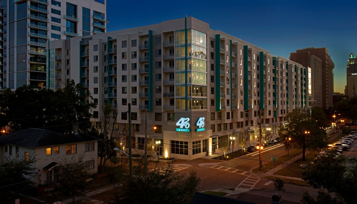 420 east apartment building exterior at night - jefferson apartment group