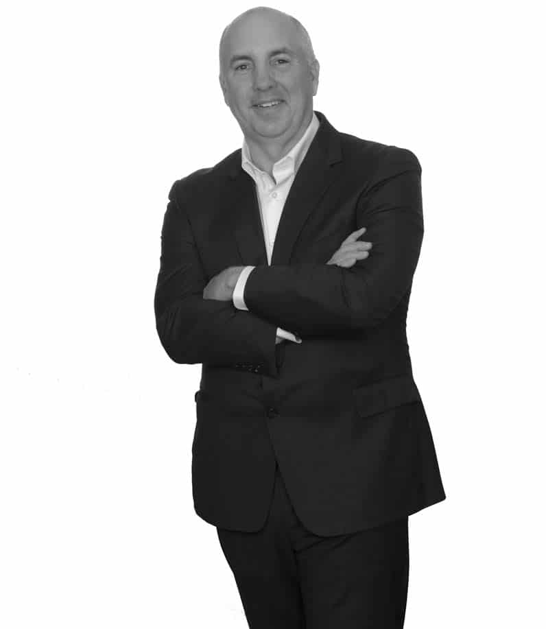 black and white standing photo of greg lamb executive vice president and coo, black and white standing up - jefferson apartment group