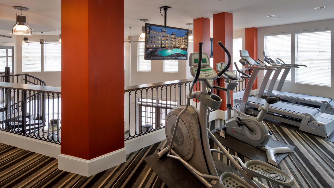 jefferson pointe fitness center with flat screen tv and cardio machines