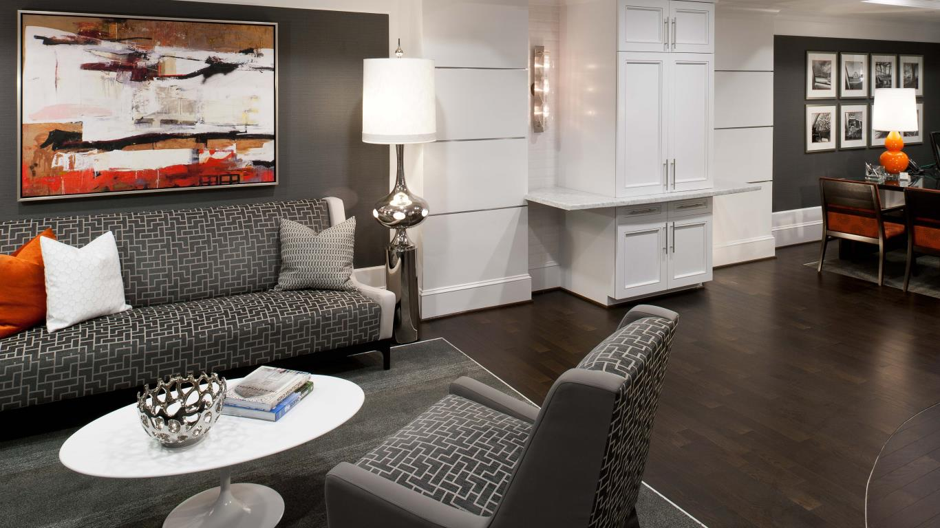 jefferson west pointe at west chester resident lounge with couch, chairs, cocktail tables and modern artwork - jefferson apartment group