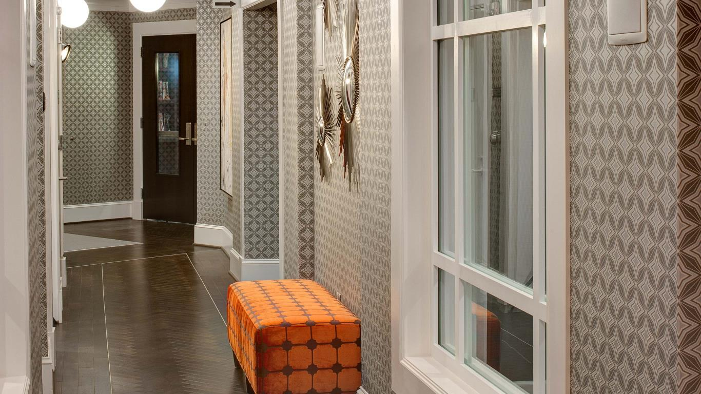 jefferson pointe at west chester hallway with decorative wall paper and bench seating - jefferson apartment group