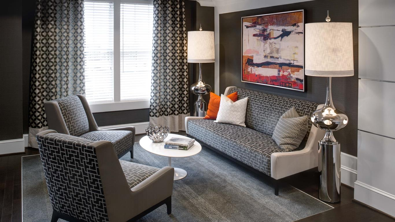 jefferson pointe at west chester resident lounge with couch, chairs, modern lamps and cocktail table - jefferson apartment group