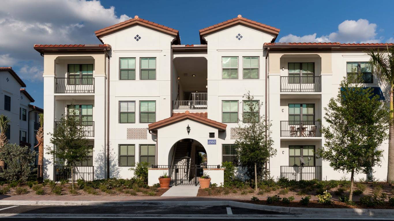 jefferson monterra building exterior showing three story building with balconies and lush green landscaping - jefferson apartment group