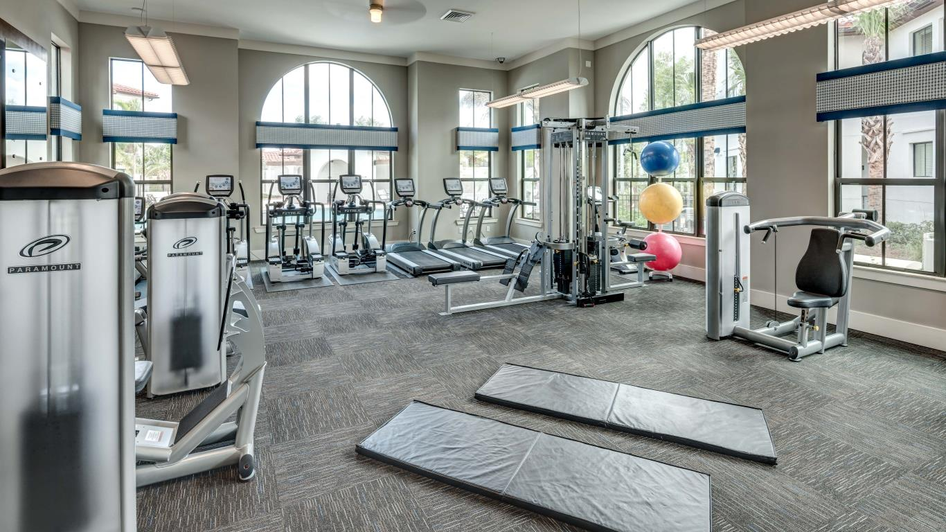 jefferson monterra fitness center with large windows, exercise balls, strength training machines and cardio equipment - jefferson apartment group