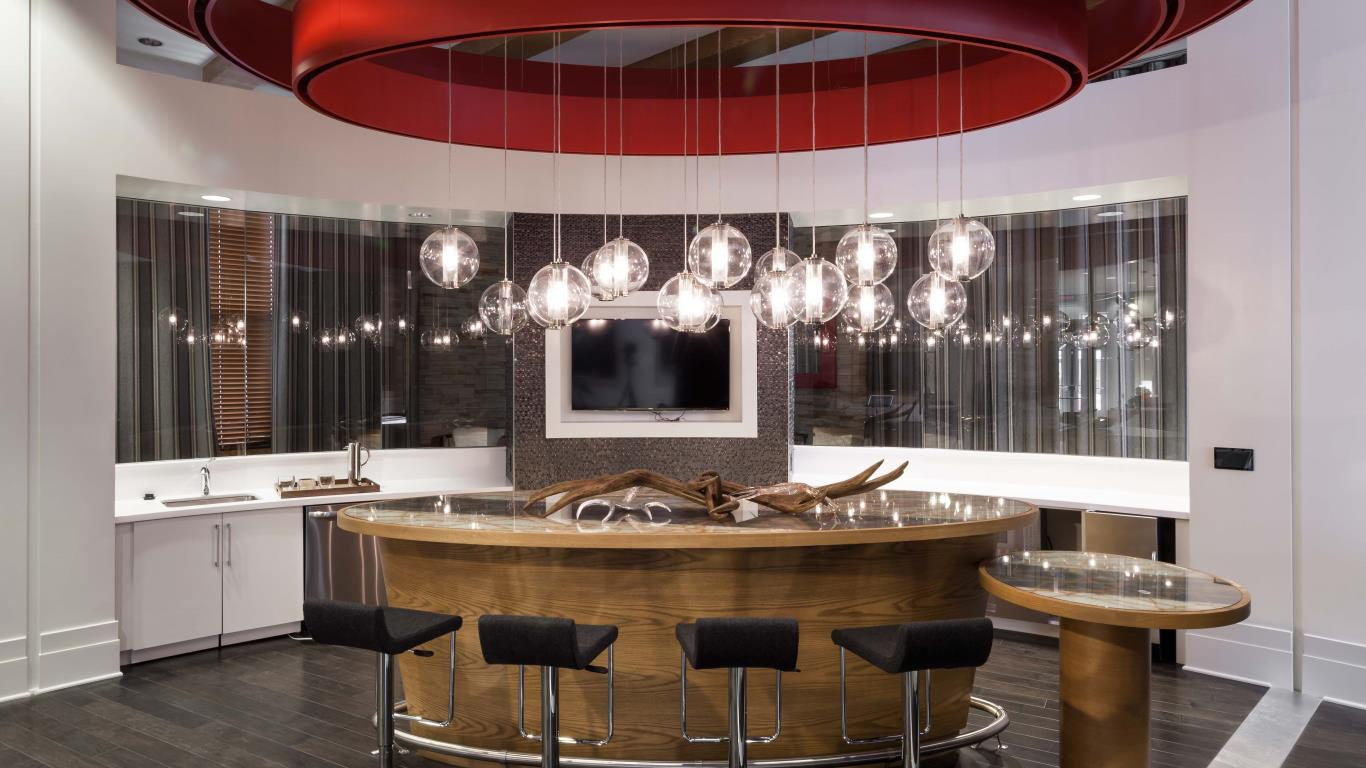 jefferson marketplace bar seating with flat screen tv and modern lighting - jefferson apartment group