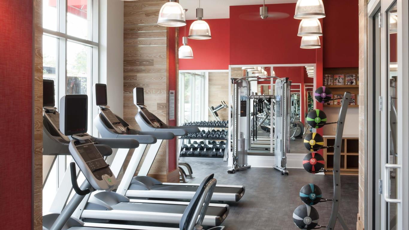 jefferson marketplace fitness center with large windows, exercise balls, strength training machines and cardio equipment - jefferson apartment group