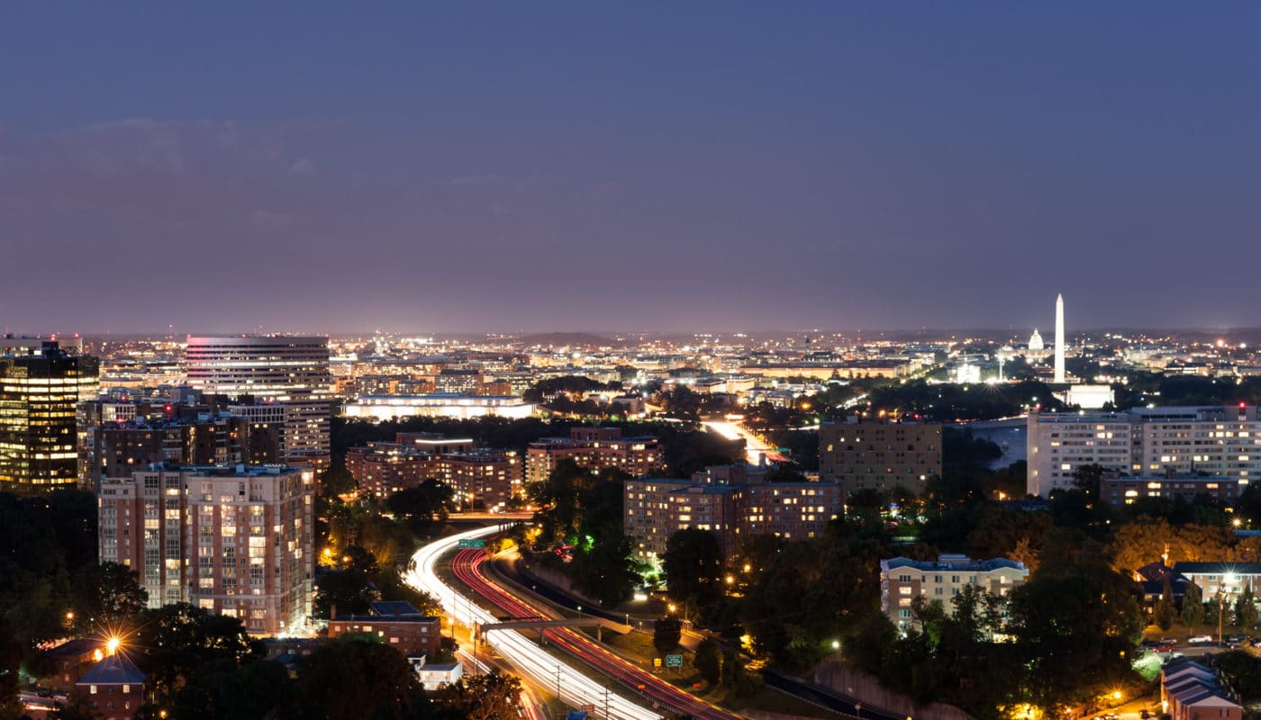 night time view of dc and arlington view-able from the rooftop of tellus - jefferson apartment group