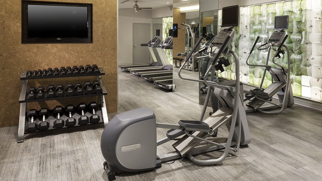 tellus fitness center with cardio machines. free weights, and flat screen tv - jefferson apartment group