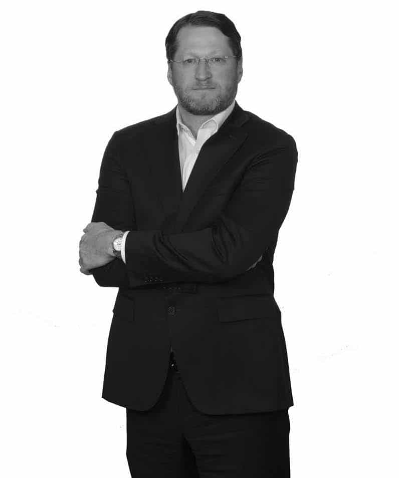 black and white image of james duncan, standing up executive vice president and cfo - jefferson apartment group