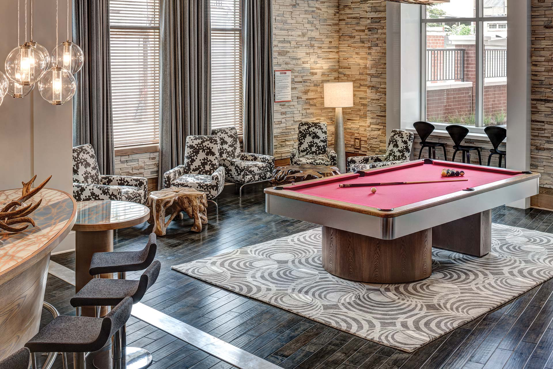 jefferson marketplace game room with billiards, bar seating, social seating and modern lighting - jefferson apartment group