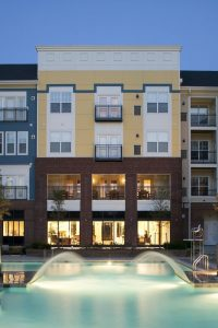 residences at congressional village resort style pool with water features and view of apartment building in the background - jefferson apartment group