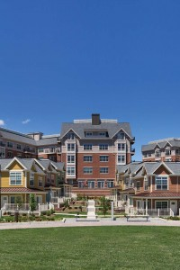 arlington 360 exterior showing apartment buildings, town homes, and resident lounge with green lawn and bench seating - jefferson apartment group