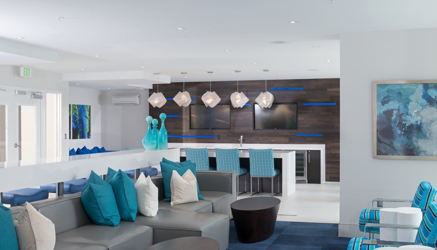 resident lounge with bar seating, demonstration kitchen, social seating, modern lighting and modern artwork - jefferson apartment group