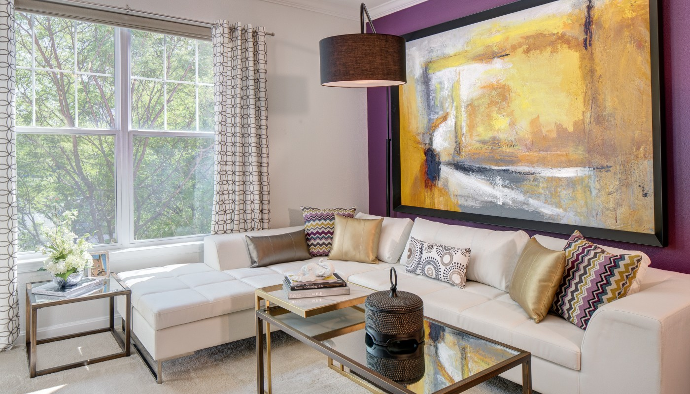 congressional village living area with sectional sofa, coffee table, end table, large window and modern artwork - jefferson apartment group