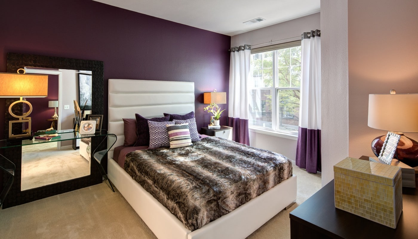 congressional village bedroom with bed, desk, night stand, dresser, large windows and modern artwork and lighting - jefferson apartment group