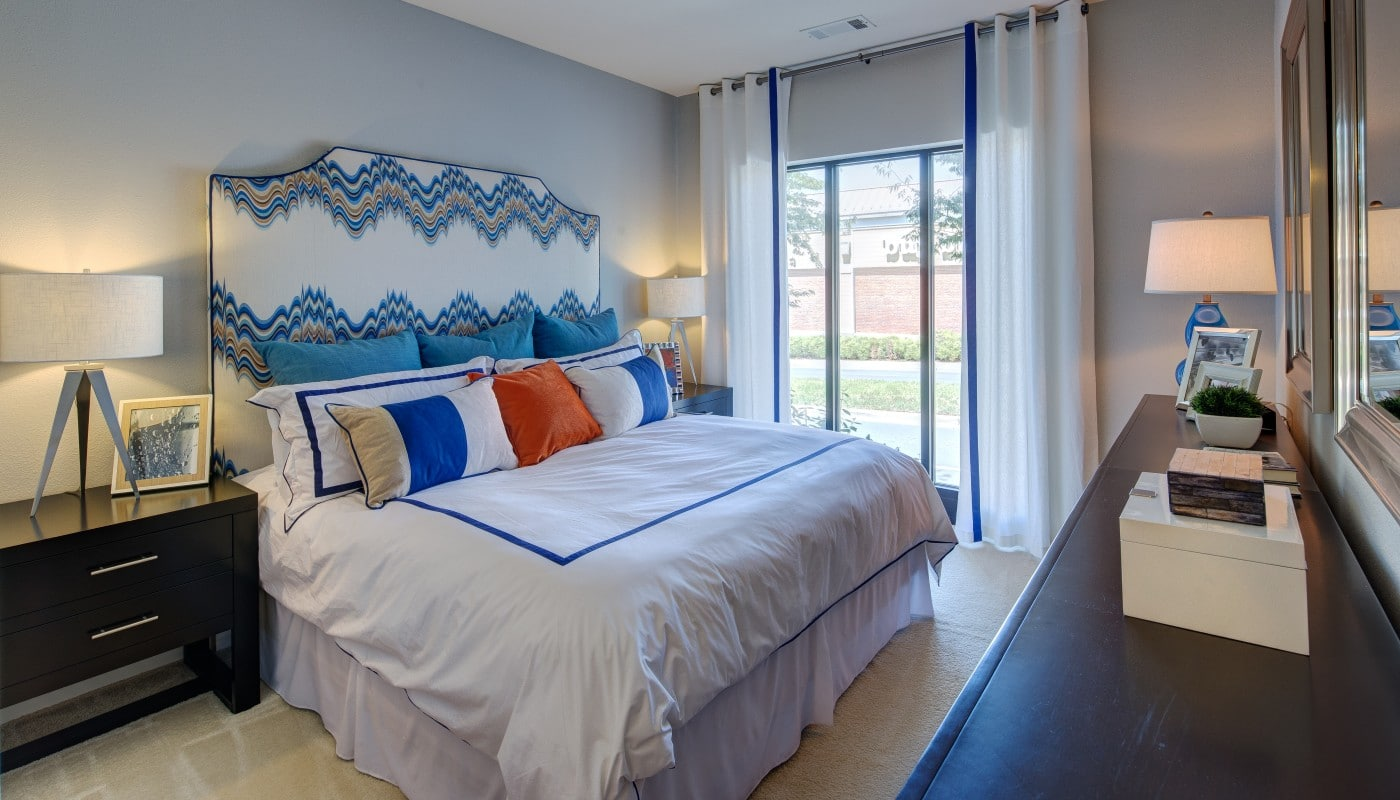 congressional village bedroom with bedroom, dresser, night stand, mirror and large windows - jefferson apartment group