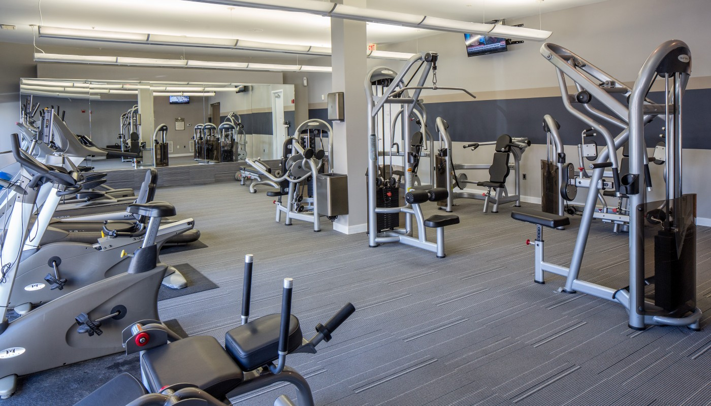 congressional village fitness center with cardio equipment, strength training machines, mirrors and a flat screen tv - jefferson apartment group
