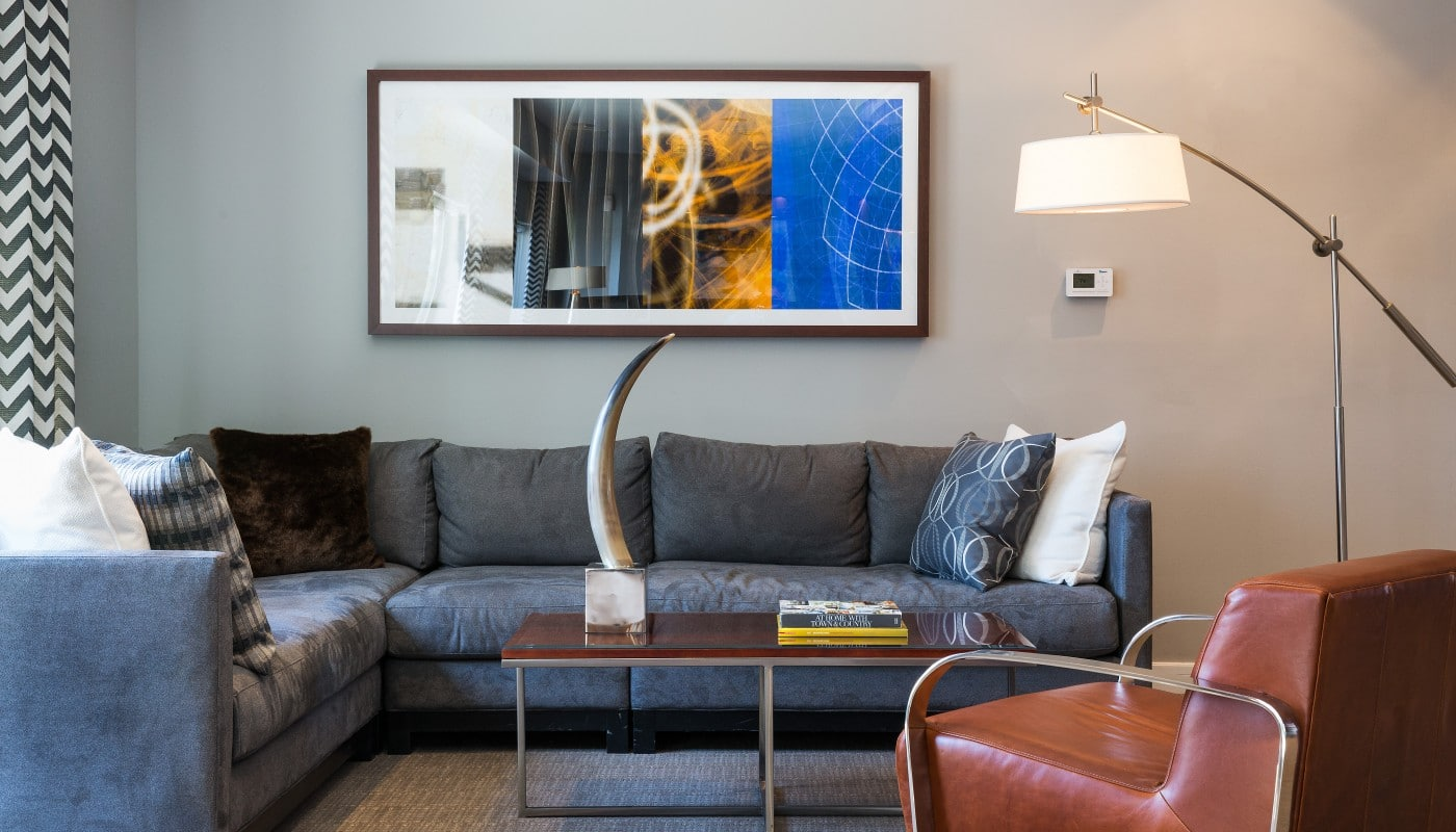 congressional village living area with sectional sofa, coffee table, side chair, modern artwork and lighting - jefferson apartment group
