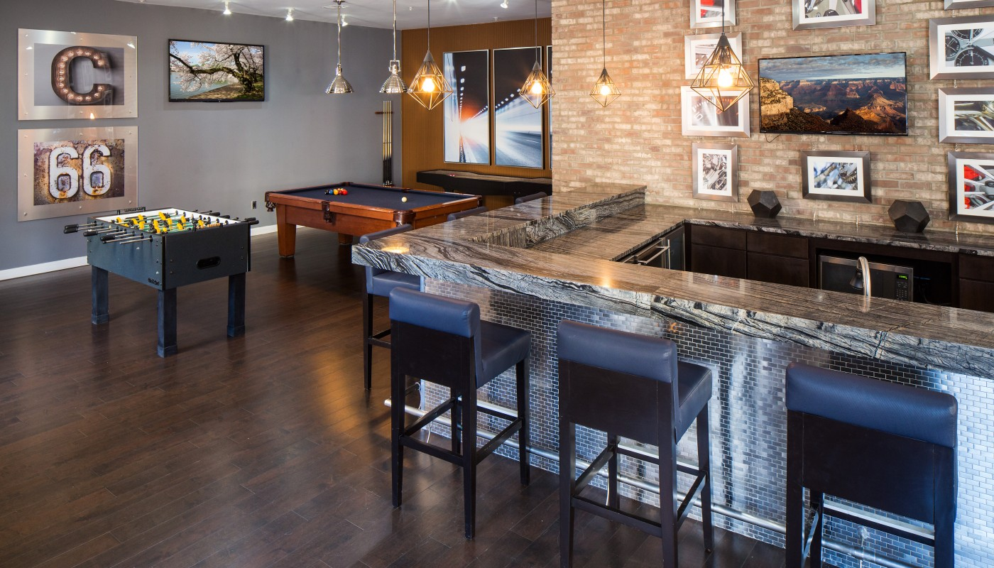 congressional village club room with billiards, foosball, bar seating and flat screen tv - jefferson apartment group