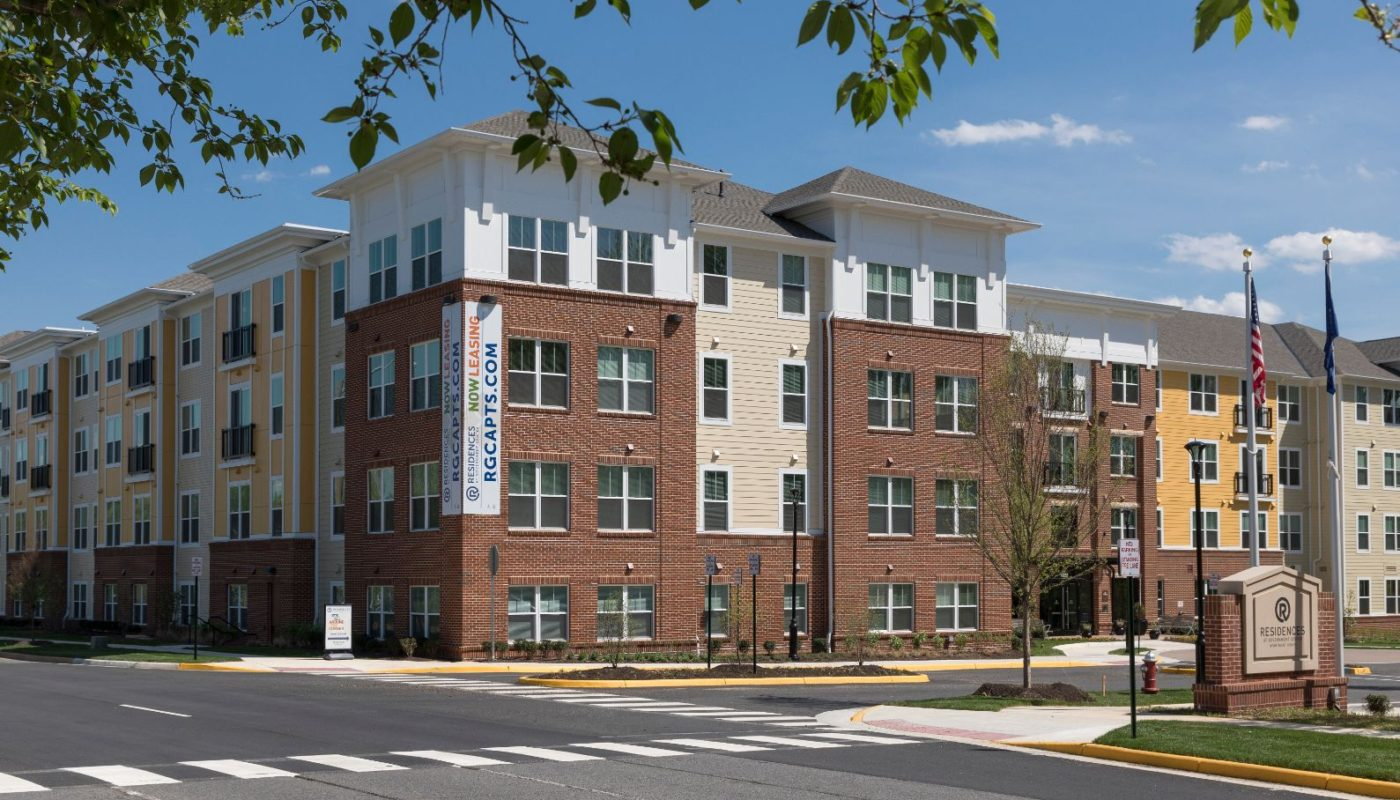 exterior of 4 story apartment building called residences at government center in fairfax va