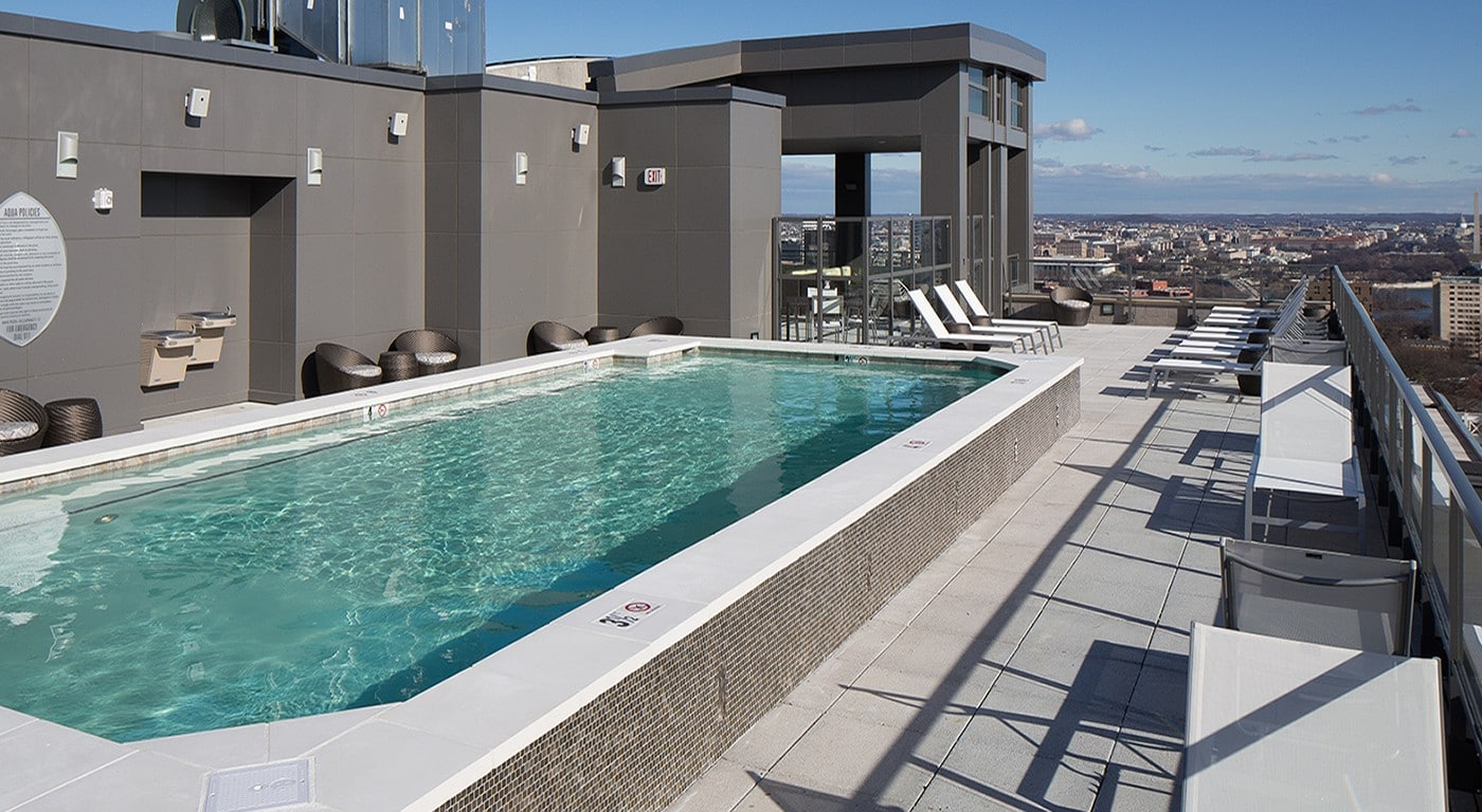 tellus rooftop pool with chaise lounge chairs, social seating and outdoor lounge - jefferson apartment group