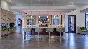 jefferson square resident lounge with bar seating, demonstration kitchen, computer gaming stations and modern lighting - jefferson apartment group