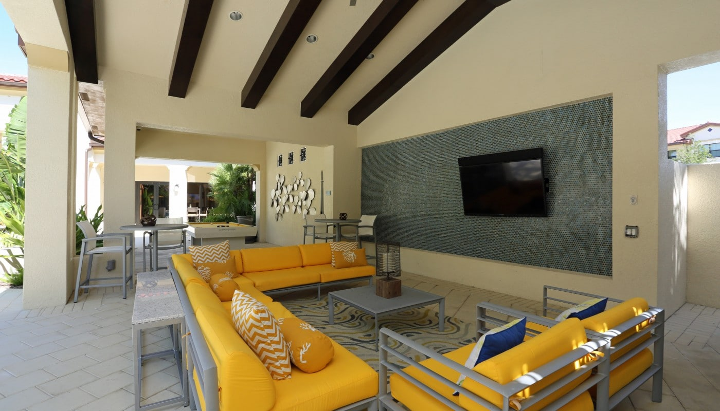 jefferson palm beach outdoor living area with social seating, billiards table and flat screen tv - jefferson apartment group
