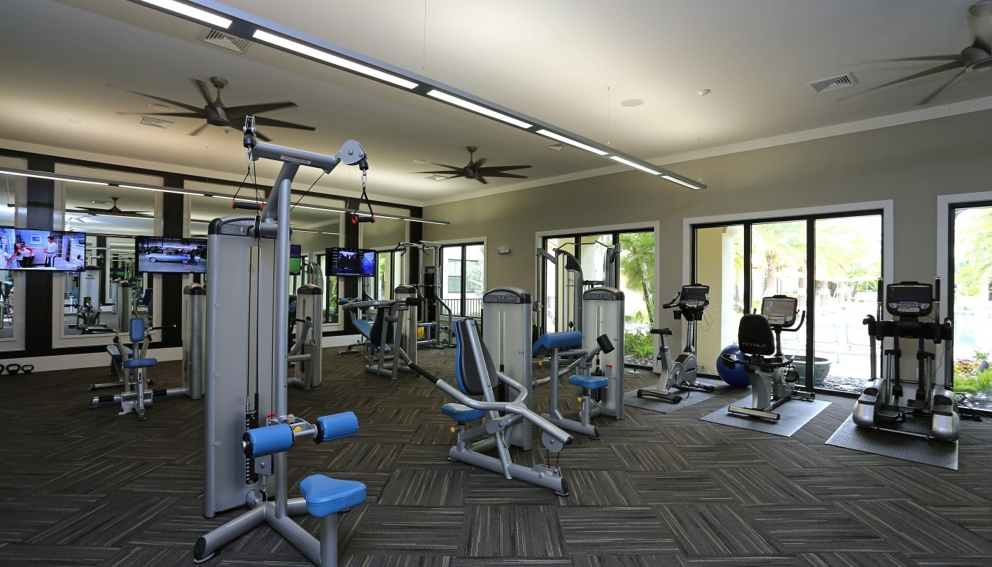 jefferson palm beach fitness center with cardio machines, strength training equipment, ceiling fans and flat screen tvs - jefferson apartment group