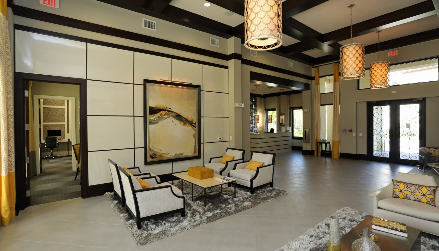 jefferson palm beach lobby with social seating, modern artwork and view of business center - jefferson apartment group