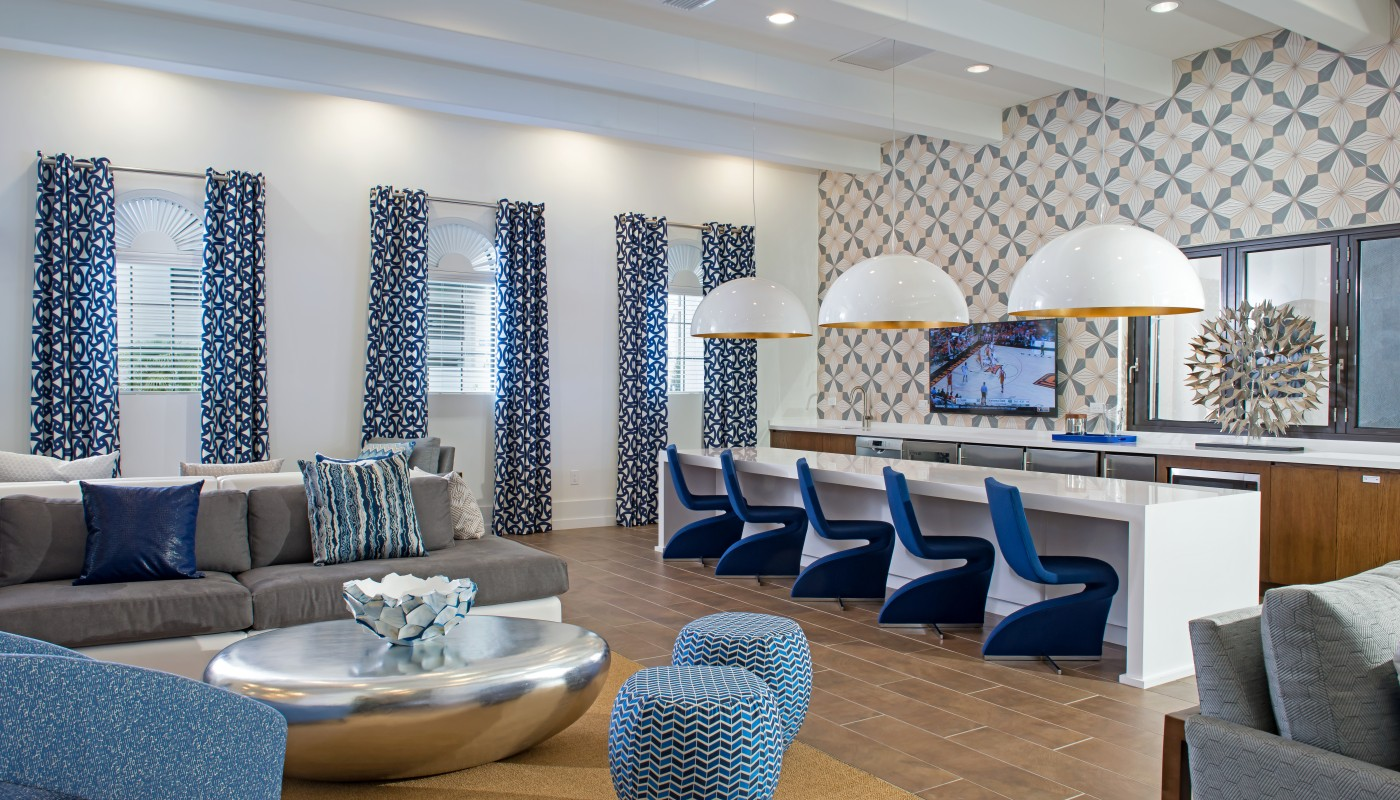 lighthouse point club room with bar seating with demonstration kitchen, sofas, social seating and modern artwork - jefferson apartment group