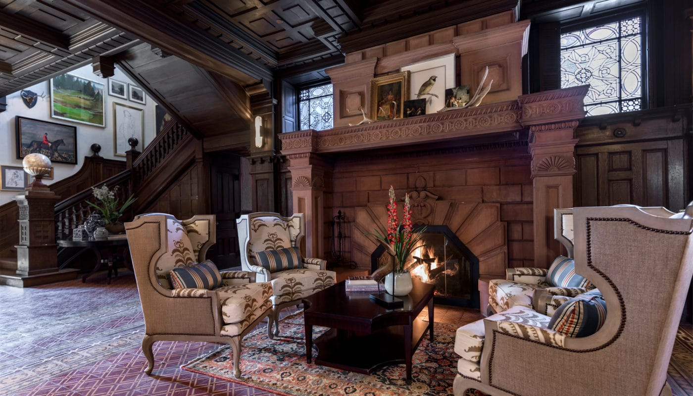 maybrook mansion grand staircase and parlor with social seating and fireplace - jefferson apartment group