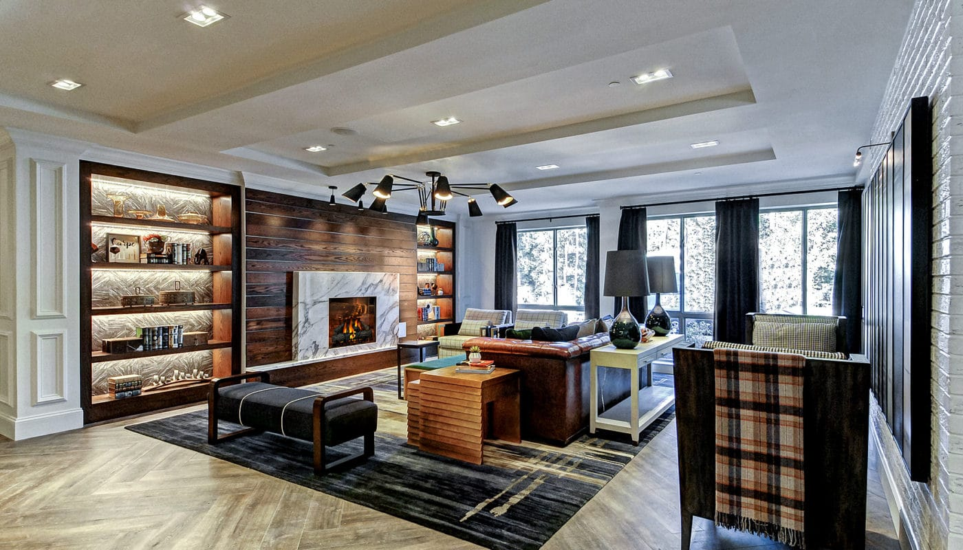maybrook resident lounge with fireplace, social seating, bookshelves, large windows and modern artwork - jefferson apartment group