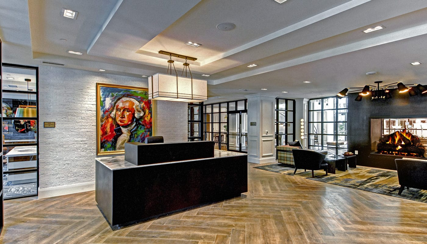 maybrook resident lounge with concierge desk, large fireplace, large windows and social seating - jefferson apartment group