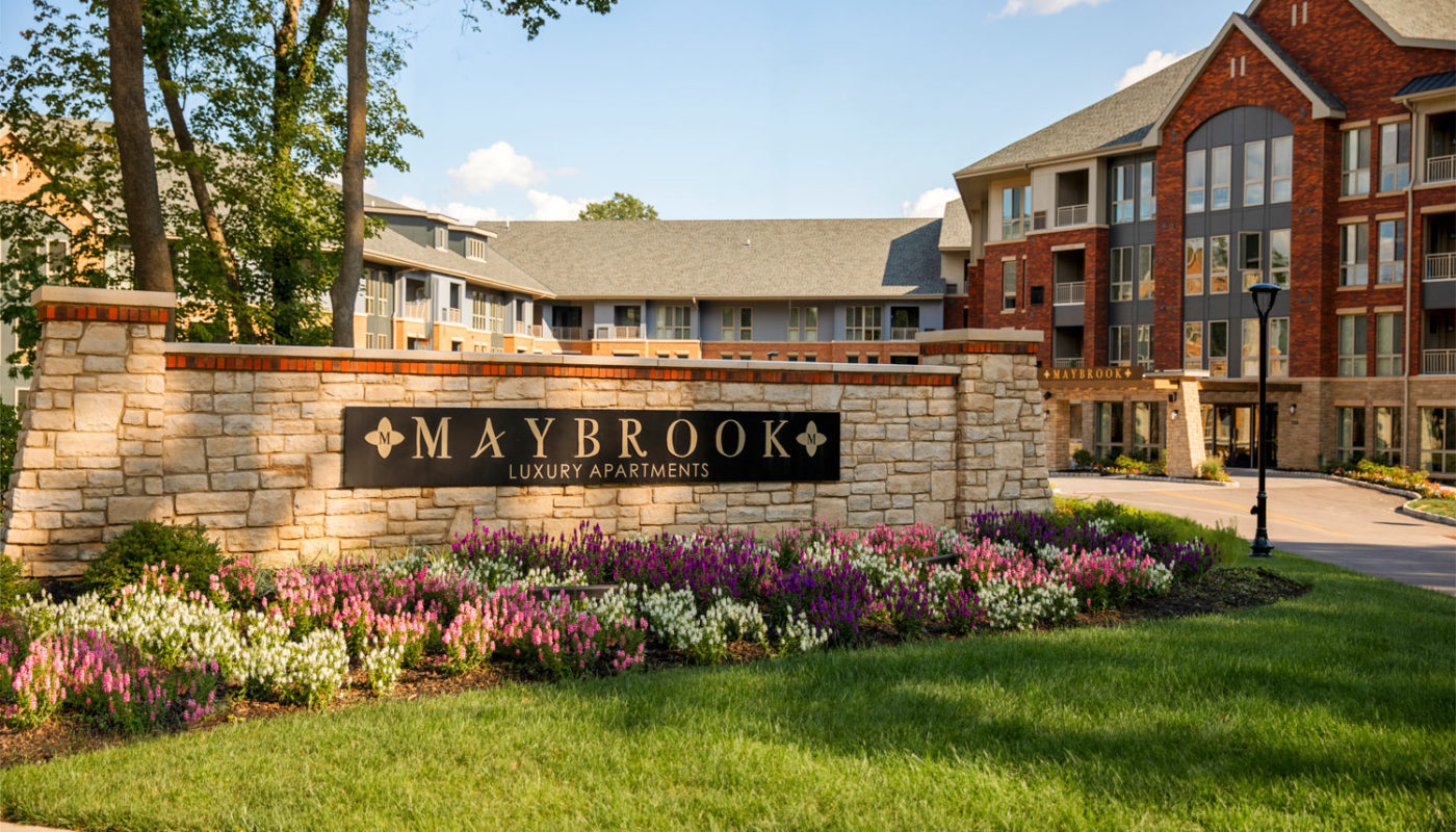 maybrook exterior and view of monument sign with green landscaping and flowers - jefferson apartment group