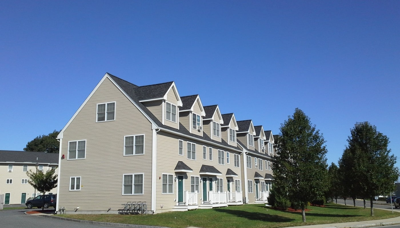 legacy park exterior showing townhomes, trees and green lawn - jefferson apartment group