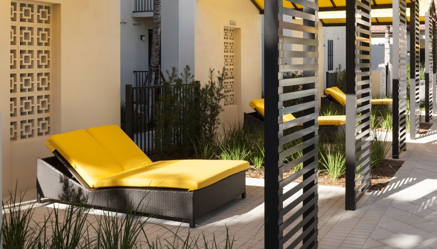 jefferson palm beach cabana with lounge chairs, greenery and shade - jefferson apartment group