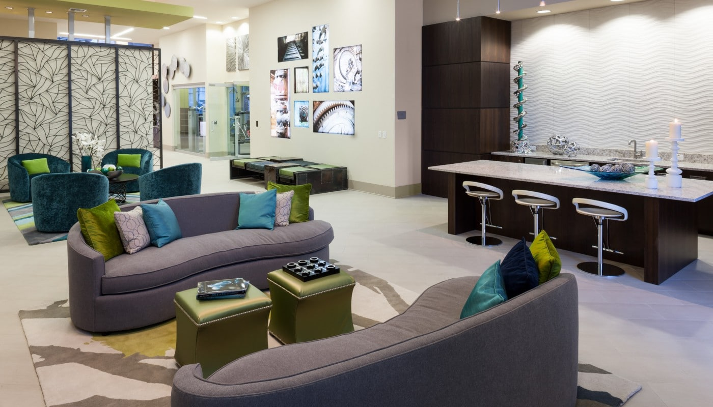 westshore resident lounge with social seating, bar area, demonstration kitchen, modern artwork - jefferson apartment group